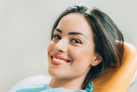 A young woman smiling in the dentist chair