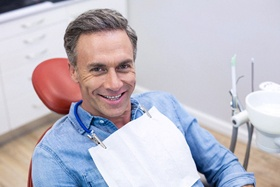 middle-aged man smiling in dental chair