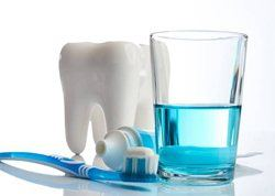 Animated tooth toothpaste and glass of oral rinse