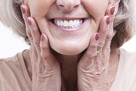 closeup of smiling older patient with dental implants in Juno Beach