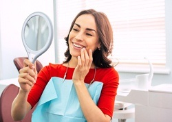 happy dental patient with mirror