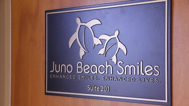 Juno Beach Smiles wall sign
