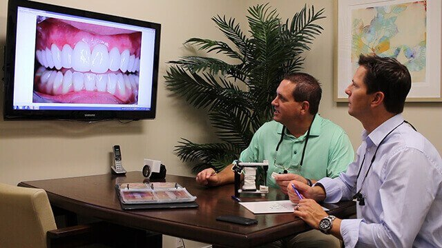 Juno Beach Smiles dentists Dr. Riley and Dr. Keuning working