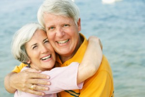 couple with dental crowns smiling