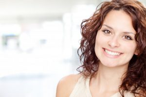 woman brunette smiling with gorgeous teeth