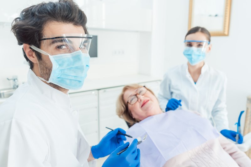 Dentist near Jupiter wearing PPE with patient
