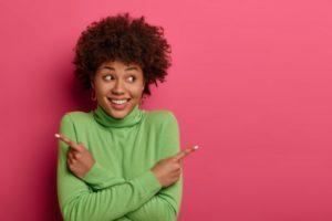 woman smiling and choosing veneers or crowns